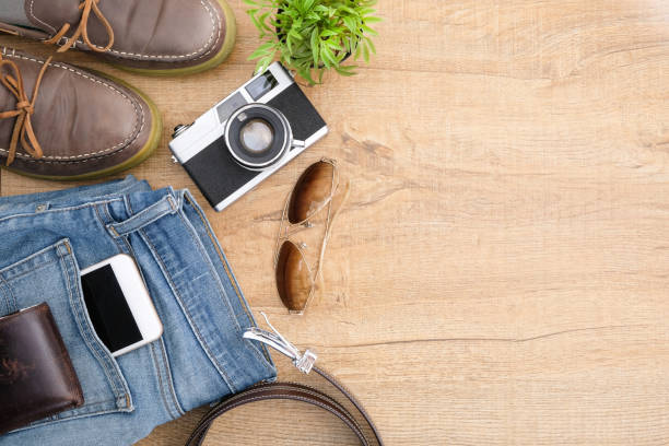 hipster travel accessories including a retro film camera. top view with copy space, flat lay. - pocket stock photos and pictures