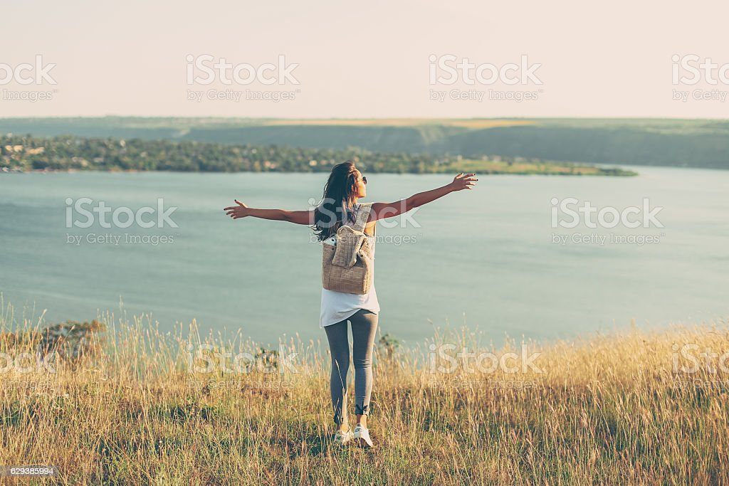 Hipster Travel girl with backpack stock photo