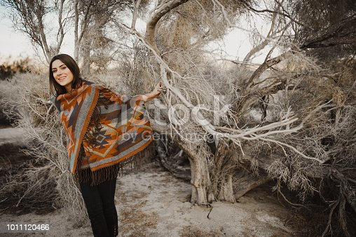 Boho woman in the desert nature.  Artistic photo of young hipster traveler girl in gypsy look,
