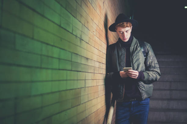 Hipster using smart phone stock photo