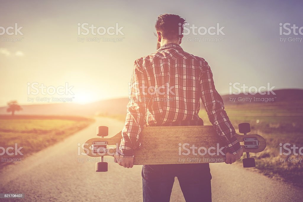 Hipster watching sunset stock photo