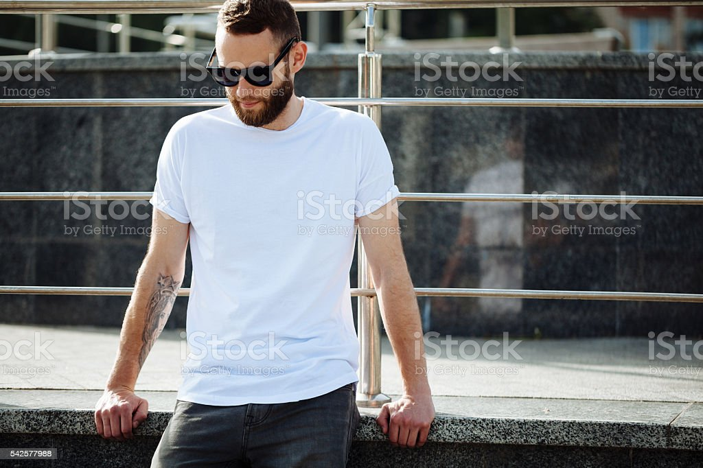 Hipster wearing white blank t-shirt with space for your logo royalty-free stock photo