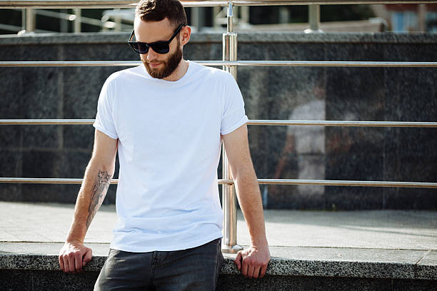 hipster wearing white blank t-shirt with space for your logo - t shirt stock photos and pictures
