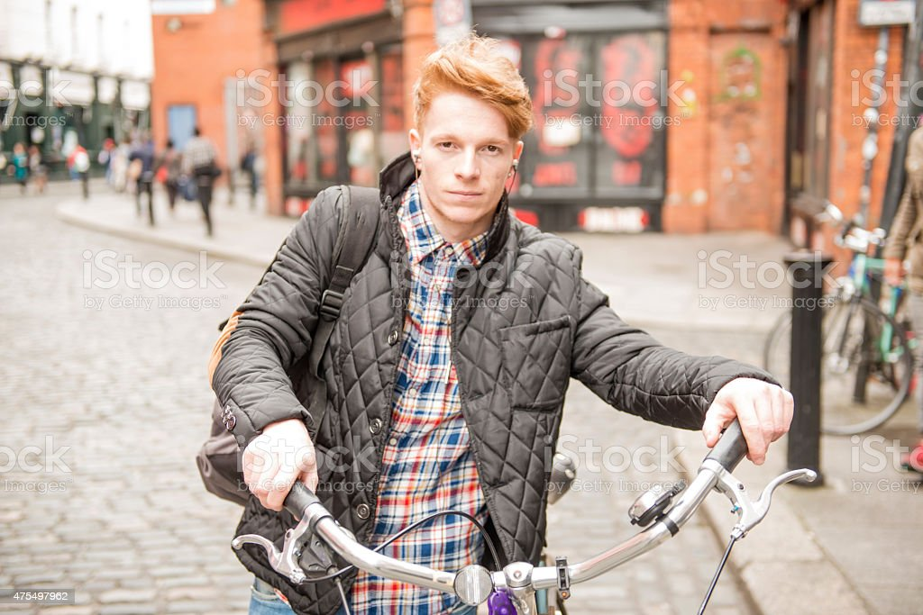 Hipster with Bike in city royalty-free stock photo