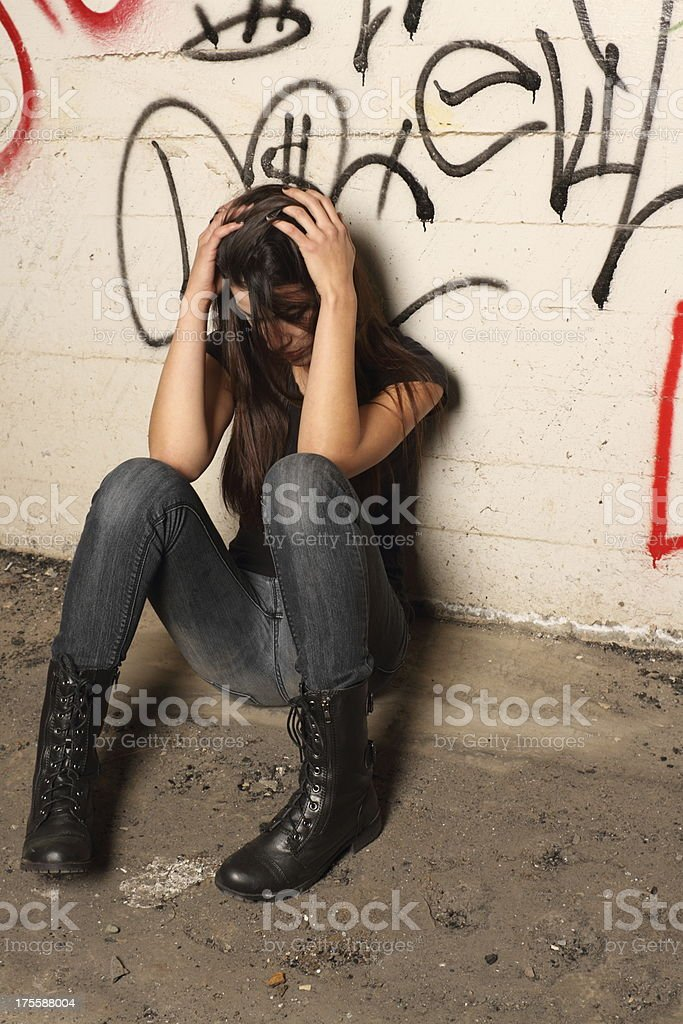 Hipster Woman in Graffiti Room Hands on Head stock photo