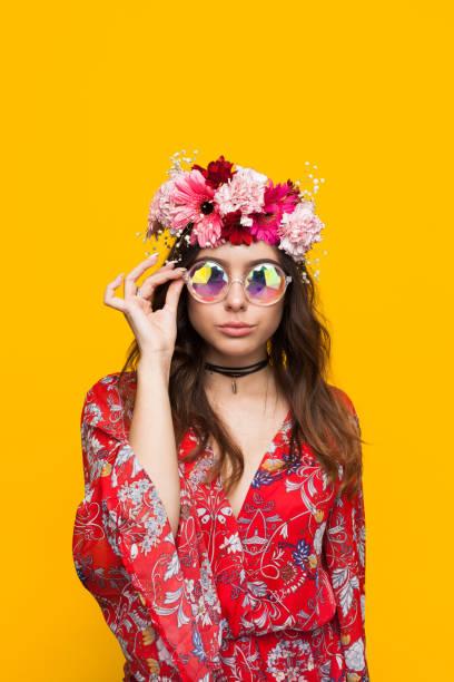 Hipster woman wearing flower chaplet touching glasses picture id817409870?b=1&k=6&m=817409870&s=612x612&w=0&h=vxdhbt8slqfbjgumewcmqi0d e3bn 4jjht3ofdv29y=
