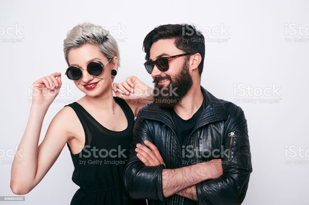 Hipster young bearded man and trendy blond woman stock photo
