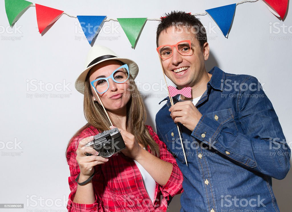 Hipster young couple in a Photo Booth party stock photo