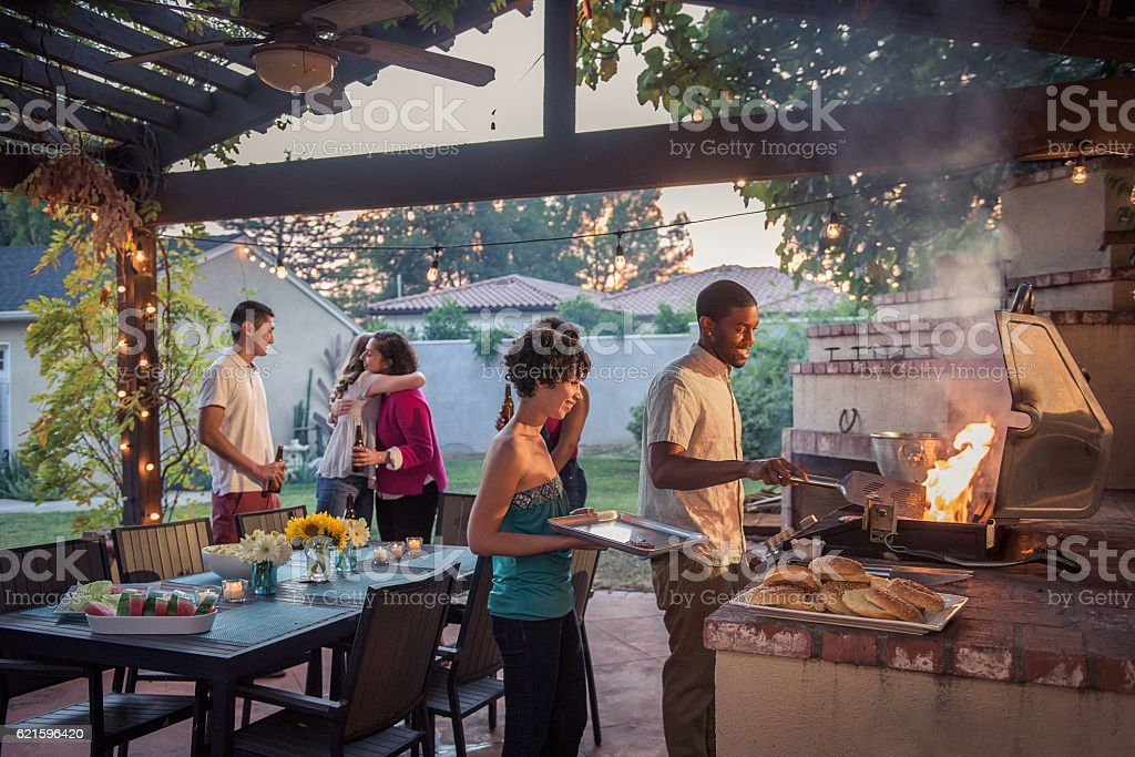 Hipsters Grilling at a Summer Backyard BBQ - Photo