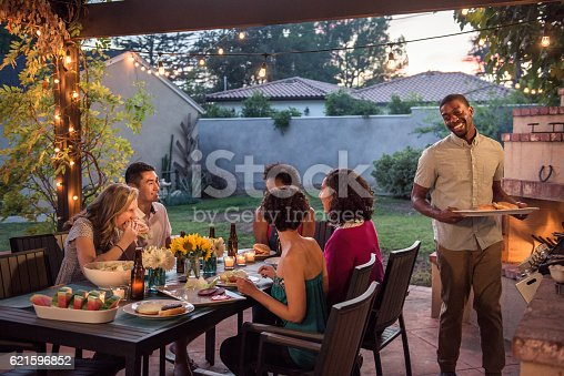 istock Hipsters Grilling at a Summer Backyard BBQ 621596852