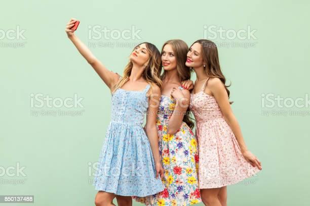 Hipsters three friends in casual dress macking selfie on green and picture id850137488?b=1&k=6&m=850137488&s=612x612&h=c7f765cwpb742v7wyf4pe9ux gerrn unxmxeuahnui=