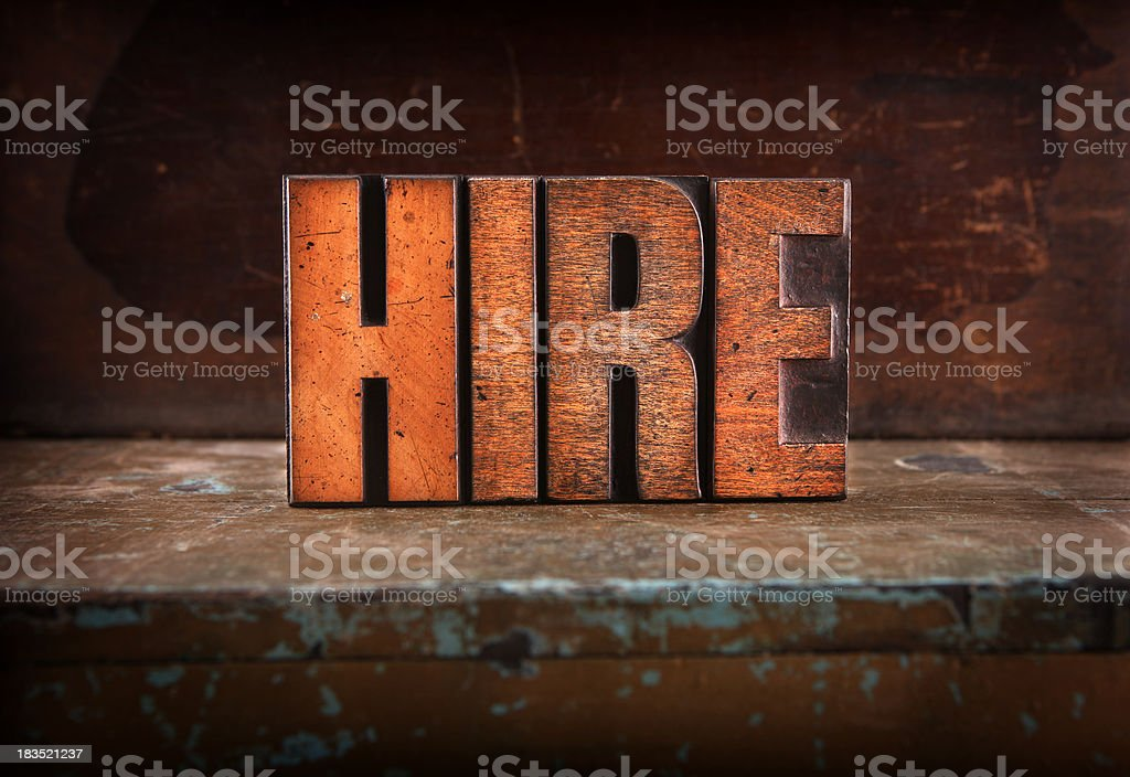 Hire - Letterpress letters royalty-free stock photo