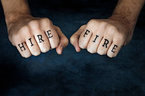 hire or fire? - knuckle stock photos and pictures