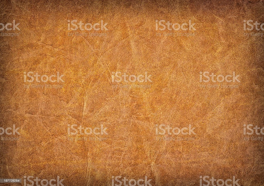 Hi-Res Antique Amber Brown Parchment Wizened Mottled Vignette Grunge Texture royalty-free stock photo