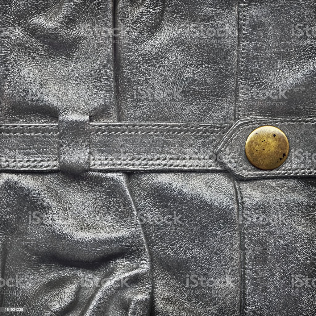 Hi-Res Black Leather Boot Shaft Strap with Brass Button Detail stock photo