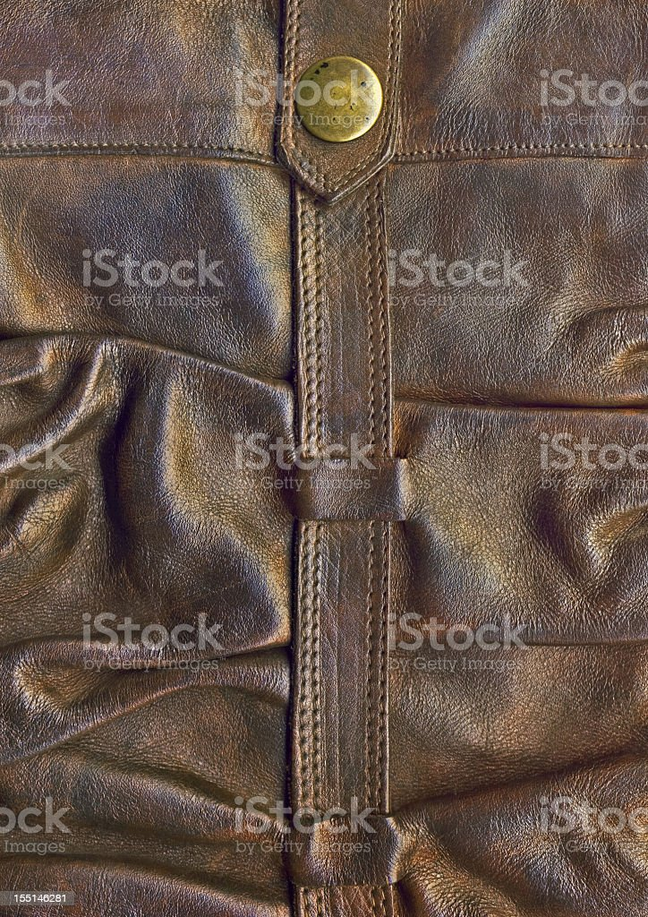 Hi-Res Brown Leather Boot Shaft Strap with Brass Button Detail stock photo