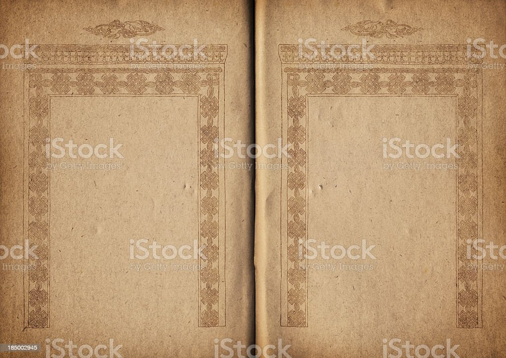 Hi-Res Medieval Book Pages Decorated with Gilded Linear Arabesque Motif royalty-free stock photo
