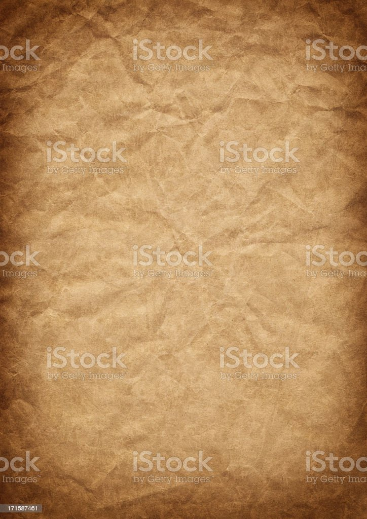 Hi-Res Old Recycled Brown Kraft Paper Crushed Vignetted Grunge Texture royalty-free stock photo