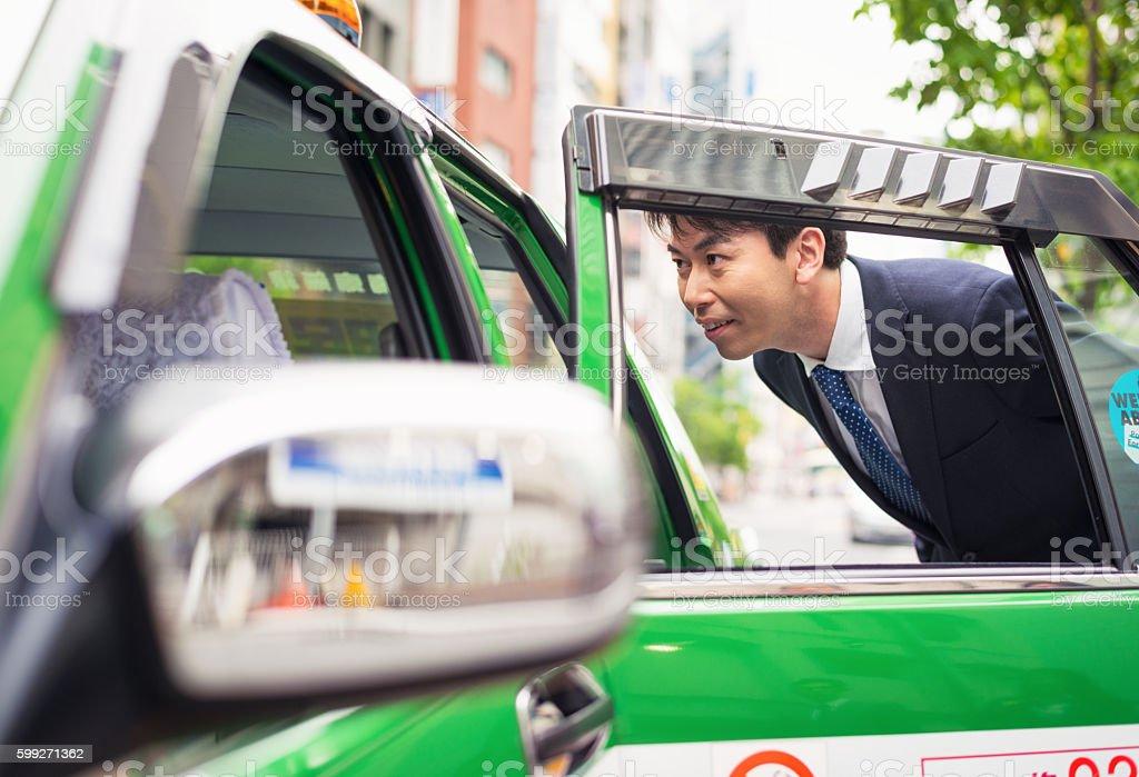 Hiring a Tokyo taxi stock photo