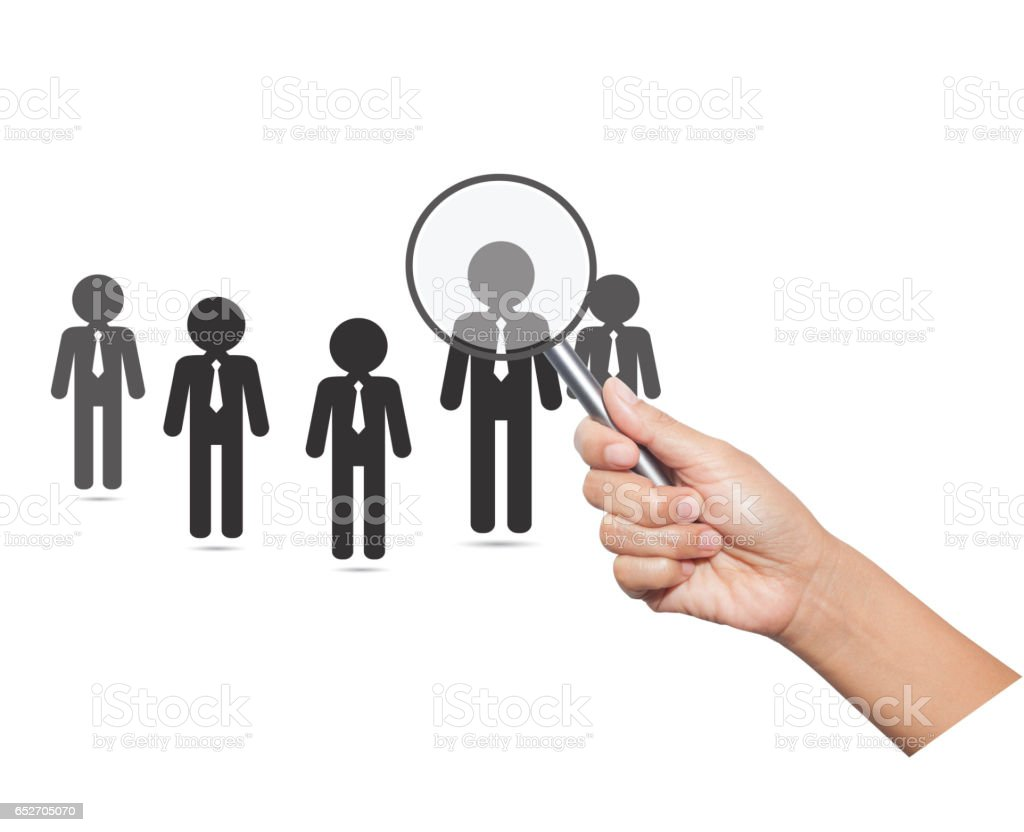 Hiring staff concept. Hand with magnifying glass finding and recruiting new worker. stock photo