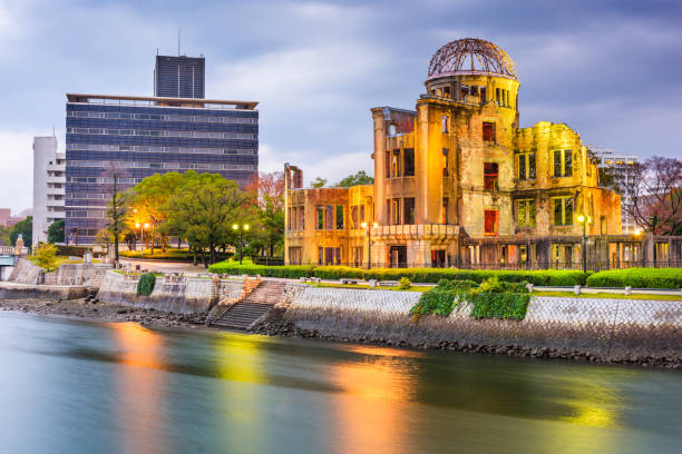Hiroshima, Japan skyline and Atomic Dome Hiroshima, Japan skyline and Atomic Dome at twilight on the river. hiroshima prefecture stock pictures, royalty-free photos & images