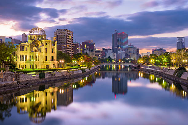 Hiroshima, Japan Skyline Hiroshima, Japan skyline at the Atomic Dome. hiroshima prefecture stock pictures, royalty-free photos & images