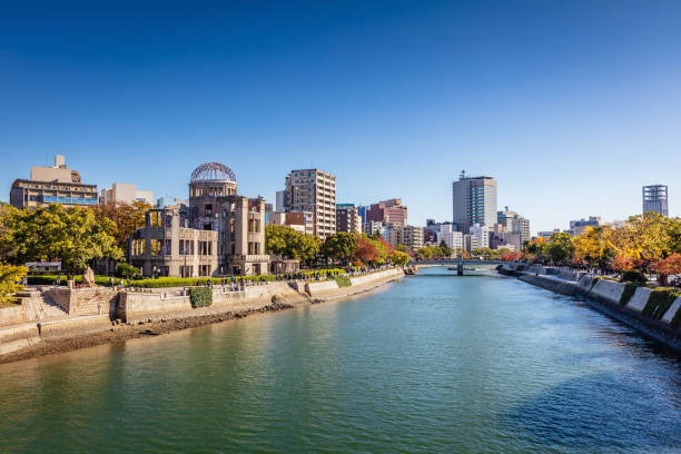 Hiroshima Motoyasu River Cityscape Atomic Bomb Dome Japan Hiroshima Cityscape on a Sunny Autumn Day. View over the Motoyasu River, Atomic Bomb Dome on the left side of the Motoyasu River. Naka Ward, Hiroshima, Japan, Asia. hiroshima prefecture stock pictures, royalty-free photos & images