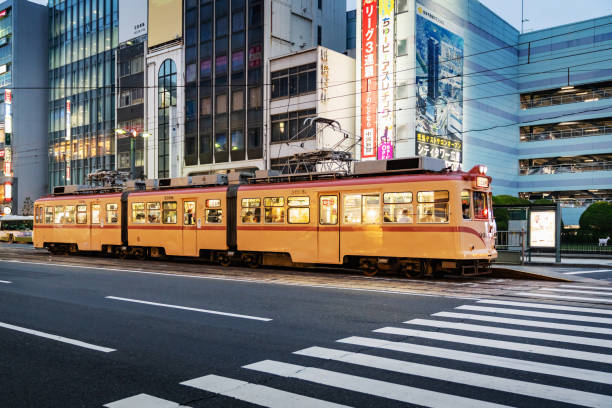 Hiroshima Streetcar at Twilight Japan Hiroshima, Japan, November 26th 2018: Downtown Hiroshima City Street at twilight with the famous illuminated Hiroshima Tram - Streetcar. Hiroshima, Honshu, Japan, Asia. hiroshima prefecture stock pictures, royalty-free photos & images