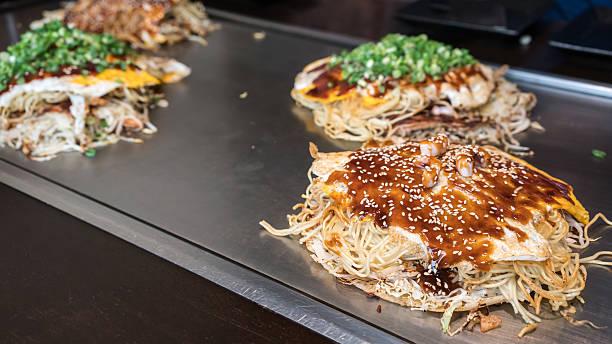hiroshima style okonomiyaki or japanese pizza - hiroshima stok fotoğraflar ve resimler