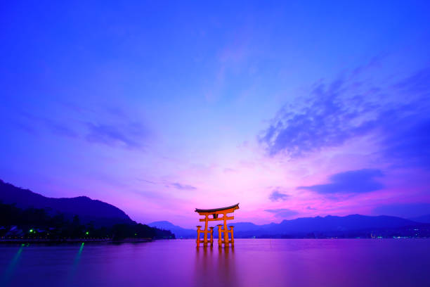 Hiroshima,Japan - July 25,2018 - Miyajima is a small island of Hiroshima in Japan. It is most famous for its giant torii gate, which at high tide seems to float on the water. Hiroshima,Japan - July 25,2018 - Miyajima is a small island of Hiroshima in Japan. It is most famous for its giant torii gate, which at high tide seems to float on the water. miyajima stock pictures, royalty-free photos & images