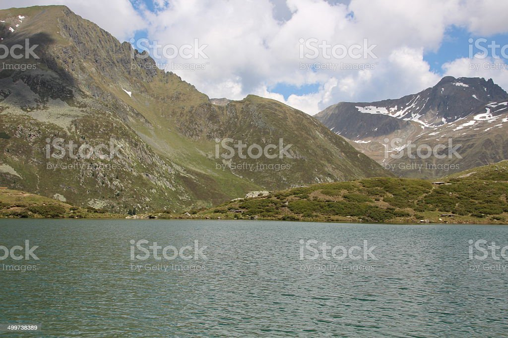 Hirschebensee, Mountain Lake in Spring Season, Kühtai, Tyrol, Austria stock photo