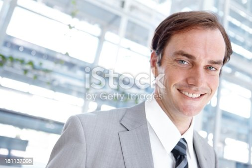 Portrait of a young businessman smiling alongside copyspace