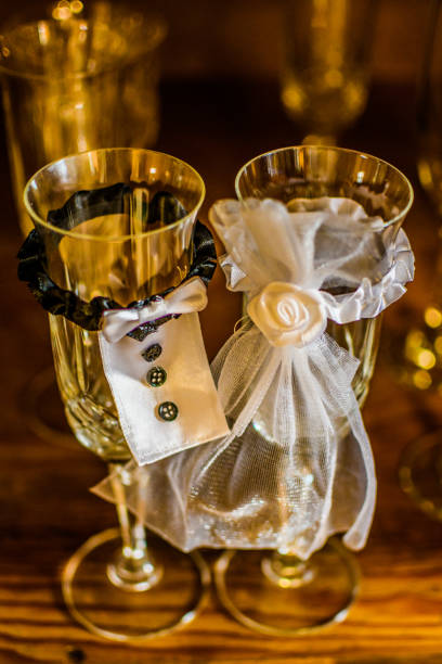 His and hers wedding day champagne glasses stock photo
