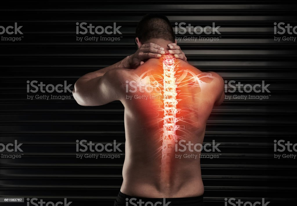 His back is a little out of sorts stock photo