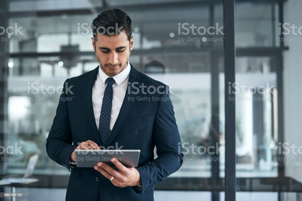 His business never runs behind thanks to modern technology stock photo