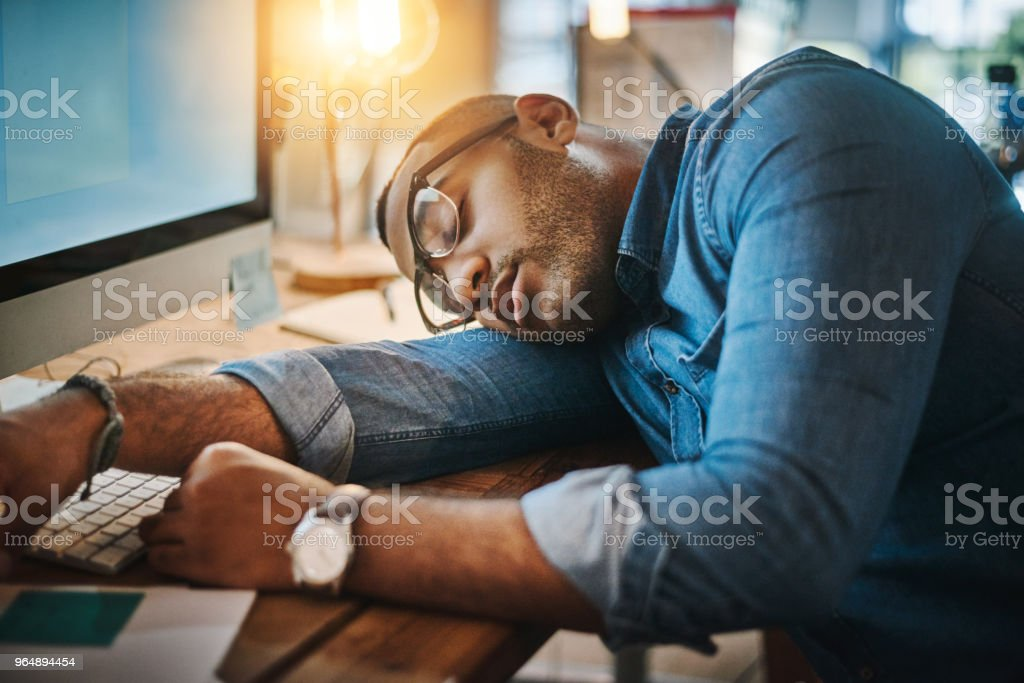 His desk will be his pillow for the night royalty-free stock photo
