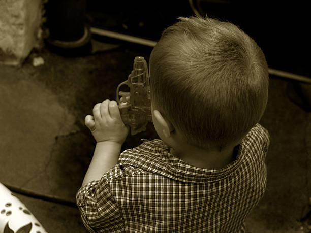 His early fascination with guns stock photo
