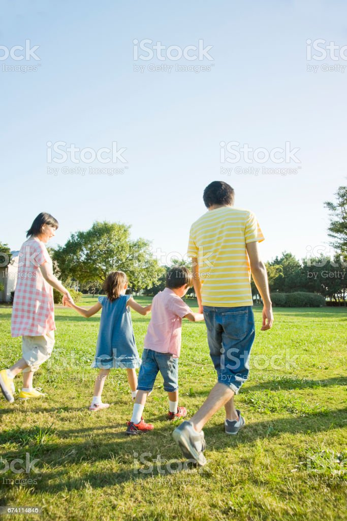 His family held hands, a walk in the Park royalty-free stock photo