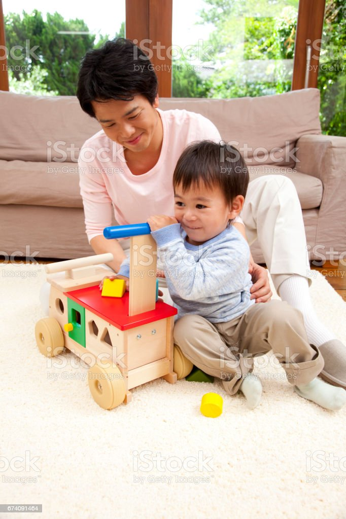 His Father Play In A Wheelbarrow And Son Stock Photo More