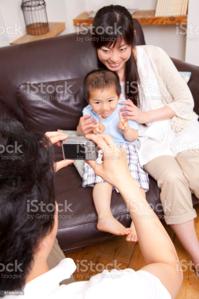 His father to shoot with a digital camera family royalty-free stock photo