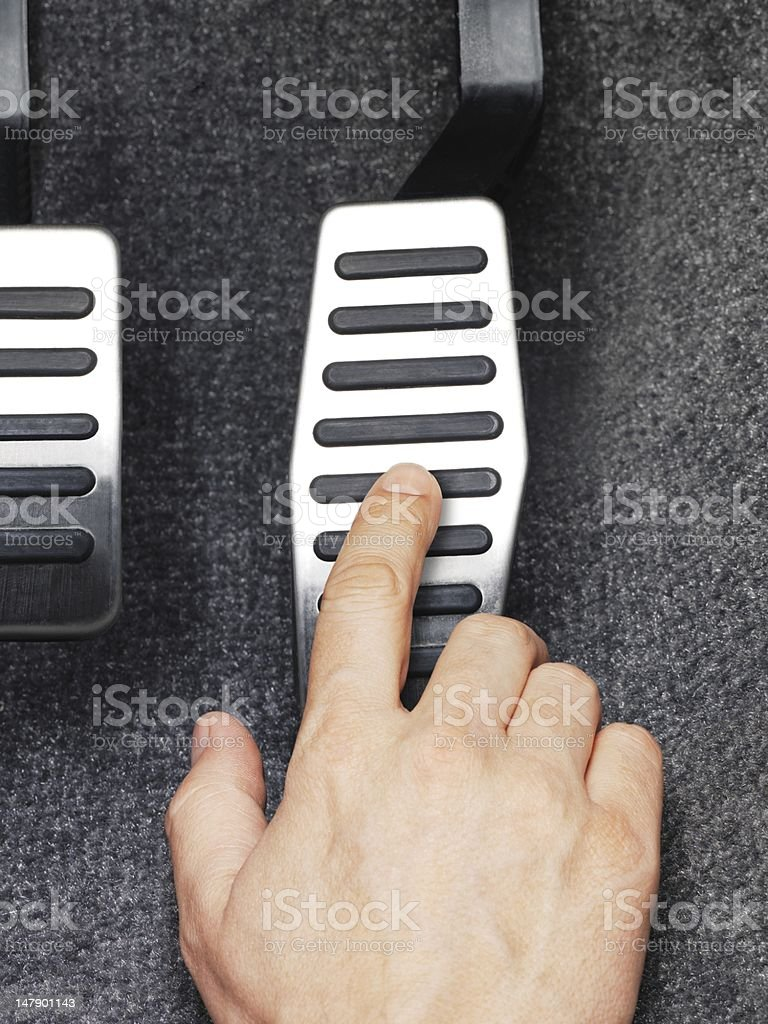His fingers pressed the gas pedal stock photo