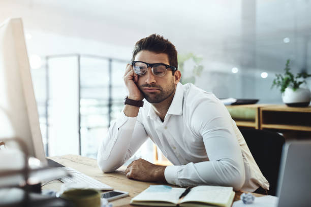 his motivation simply wandered away - sleeping in work stock photos and pictures