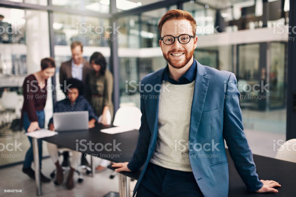 His positivity sets the tone for a productive meeting stock photo
