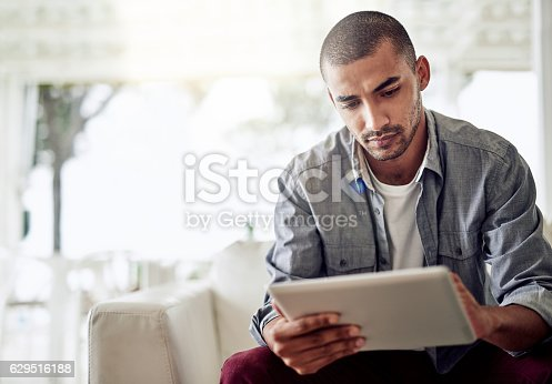 istock His tablet keeps him connected anywhere at home 629516188