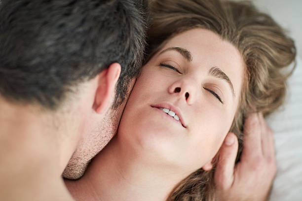 his touch took her to unimaginable levels of pleasure - kissing on neck stock photos and pictures