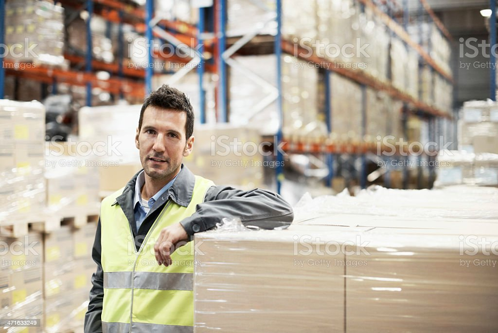His warehouse is always fully stocked Portrait of a young man leaning on some boxes in a warehouse 30-39 Years Stock Photo