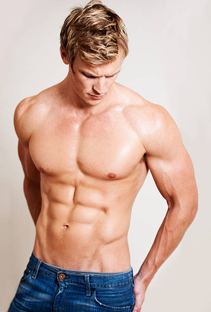 His workout paid off A sexy shirtless and muscular man posing shirtless male models stock pictures, royalty-free photos & images