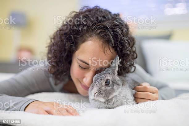 Hispanic adult female struggling with a bunny rabbit picture id629413486?b=1&k=6&m=629413486&s=612x612&h=ldzankrk8yhgsm tjaspw5kulgnh6hhls2jsqwhkvpy=