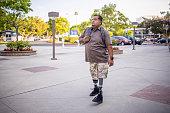 istock Hispanic American Veteran College Student Walking on Campus 1280228305