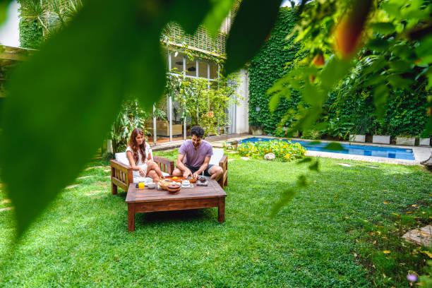 Hispanic and Mixed Race Couple Enjoying Breakfast Outdoors stock photo